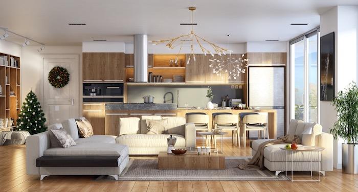 modele de cuisine americaine en bois avec crédence grise, effet béton, ilot centrale et chaises en bois, canapés gris, table basse block en bois