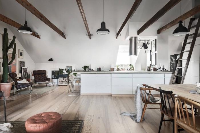 deco nordique, lampe sur pied noire, meubles de cuisine en blanc sans poignées, table à manger et chaises en bois