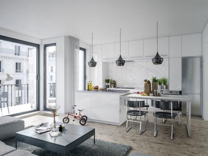 amenagement petite cuisine blanche avec credence en marbre, suspensions grises, ilot central avec extension table, salon en canapé d angle gris, table basse grise, parquet bois