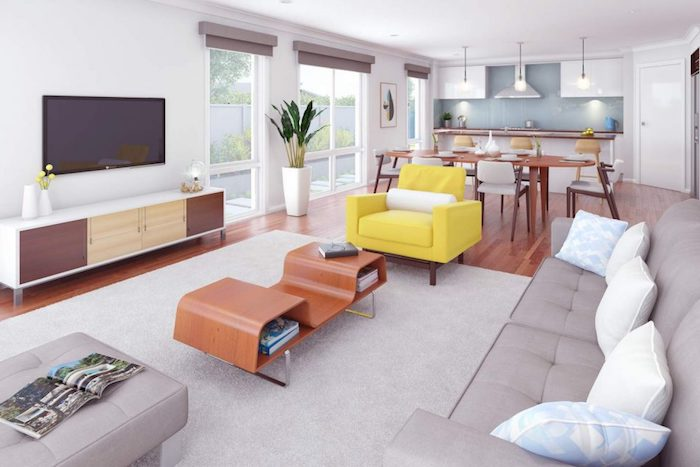 cuisine ouverte sur salon, meuble blanc et credence bleue, table et chaises en bois, ouverture salon avec canapé et tapis gris, table basse design, fauteuil jaune, meuble tv en bois
