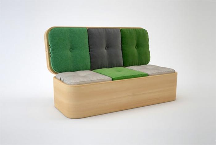 deco petite chambre adulte, chambre de 9m2, canapé avec de grands coussins en vert et gris, en revêtement imitation bois clair, transformation en table pour la salle à manger