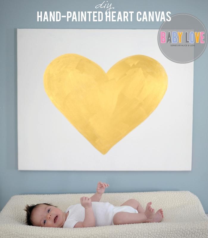 coeur à la peinture jaune sur une toile blanche, idée déco chambre bébé à faire soi meme