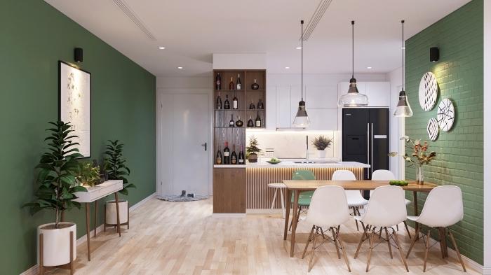 cuisine équipée, décoration murale avec assiettes blanc et noir, carrelage murale en vert avec peinture murale en vert foncé