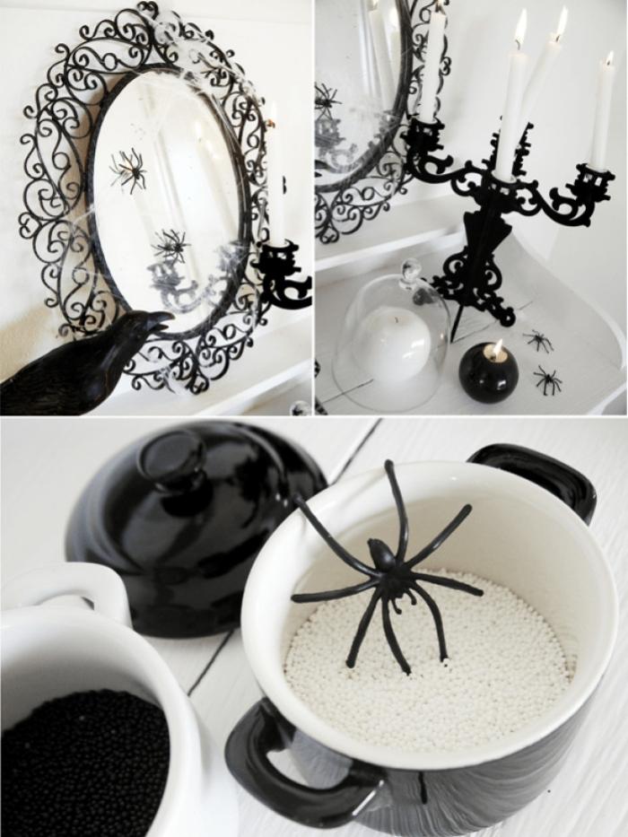 déco halloween en blanc et noir, miroir ovale en style baroque avec petites araignées décoratives et bougeoir blanc et noir