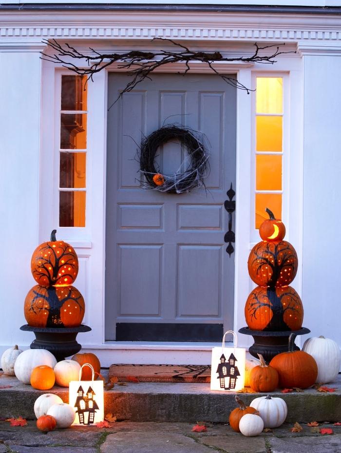 activité manuelle halloween, citrouilles peintes en blanches avec dessins arbres noirs et éclairage intérieur