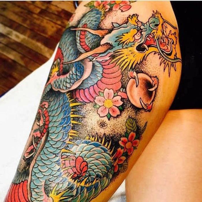 tatouage cuisse japon en couleurs de dragon asiatique
