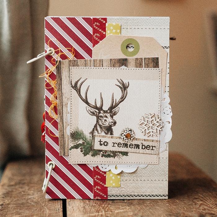 album photo personnalisé, couverture de carnet beige décorée en papier rouge à design Noel avec photo cerf