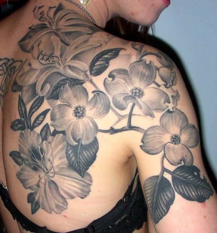 symbole orchidée tattoo fleur tattoo fleurs dos noir et blanc