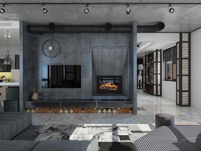 mobilier industriel, aménagement de salon loft aux murs gris avec tuyau apparent, meubles de salon canapé d'angle en gris