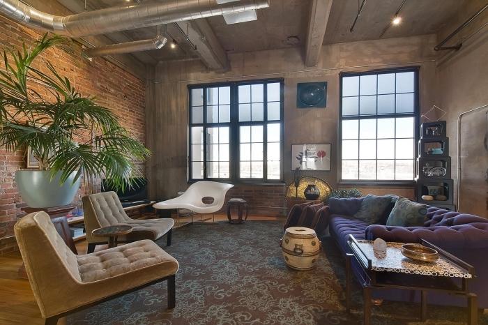 meuble style industriel, salon loft aux murs béton et en briques rouges avec tuyaux apparents de style industriel
