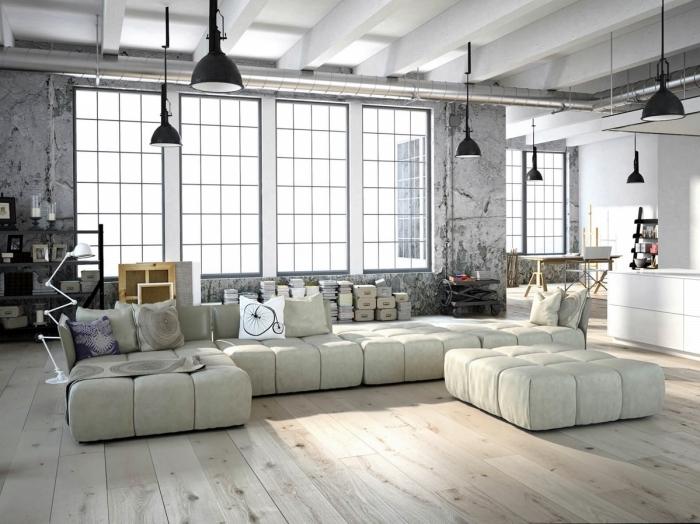 mobilier industriel, chambre loft aux murs gris et plafond blanc avec lampes suspendues noires et plancher en bois clair