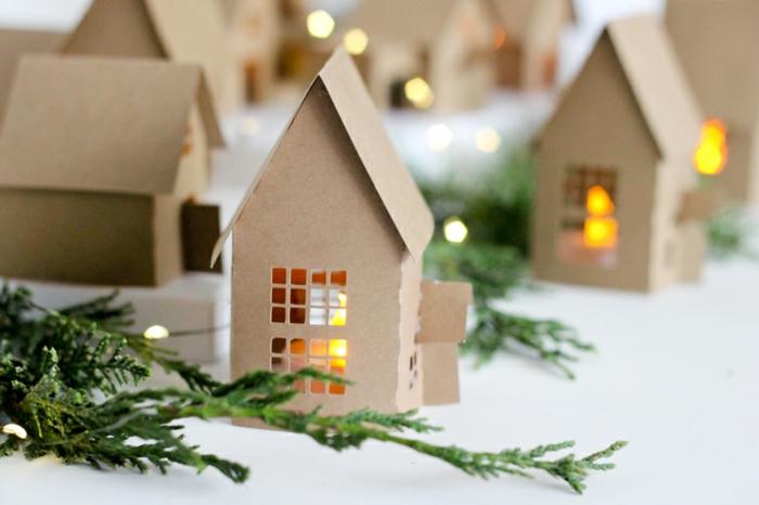 maisons en carton et lampes led illuminant l'intérieur, une magie de noel