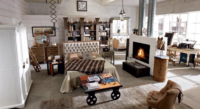 mobilier industriel, aménagement studio loft avec kingsize lit de tête boutonnée, revêtement murale en bois et briques blancs