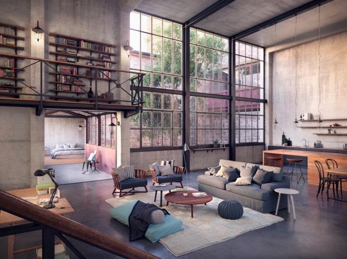 idee deco salon, chambre loft aux murs bétons avec tuyaux noirs et plancher gris anthracite, meubles en bois