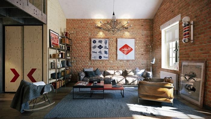 aménagement studio à design loft, salon aux murs briques et plafond blanc avec plancher en bois stratifié noir