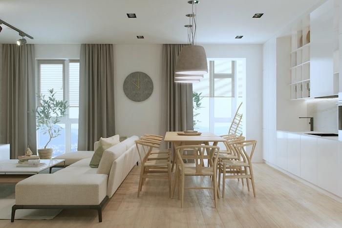comment aménager une cuisine en longueur avec façade blanche, salle à manger avec table et chaises en bois, canapé blanc et table basse design scandianve