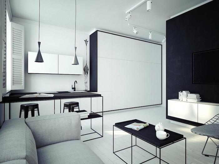 comment aménager une cuisine en longueur en blanc et noir, bar et chaises en metal, salon avec canapé gris, table basse minimaliste noire
