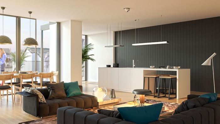 comment aménager une cuisine en longueur blanche avec mur de fond en lambris gris, canapé gris, coussins gris et bleu canard, tapis coloré, salle à manger avec chaises et table en bois