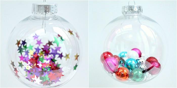 décoration sapin de noel dans une boule transparente en plastique avec des étoiles et petites boules colorées à l interieur