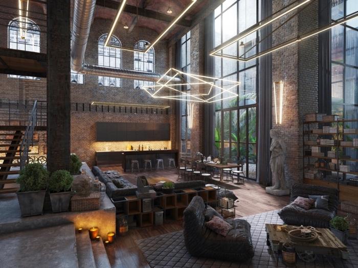 decoration d interieur, loft industriel aux murs briques et escalier noir, décoration avec plantes vertes et bougies