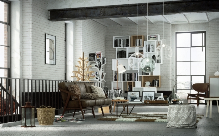aménagement studio loft aux murs briques blanches, meubles de salon en bois clair et foncé