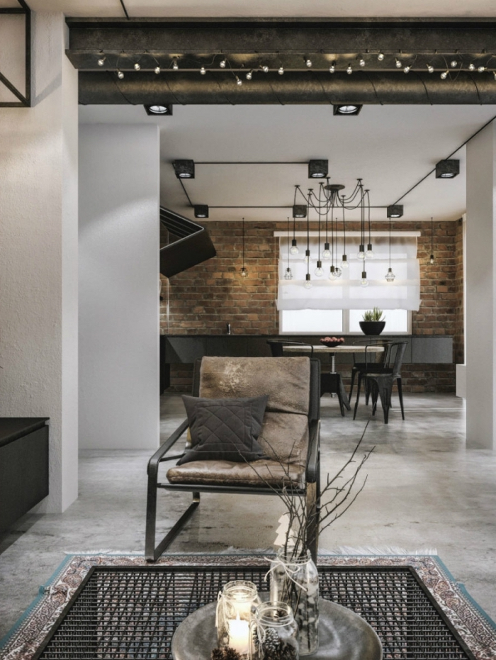 mobilier industriel, comment aménager le salon aux murs blancs et plancher béton, revêtement murale en briques rouges