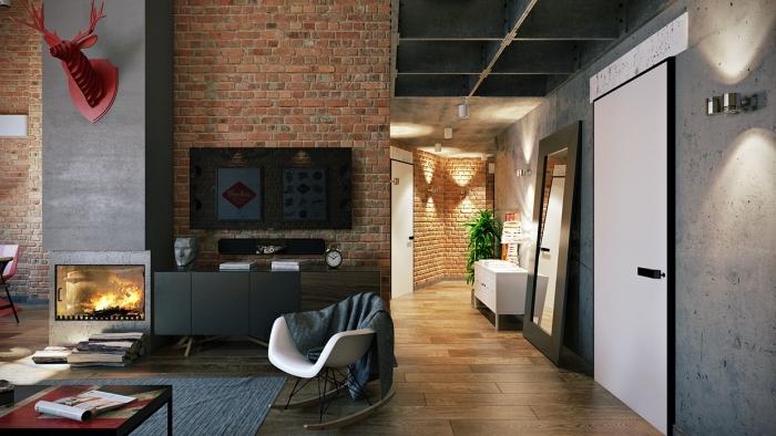 déco de chambre loft en style industriel avec cernes décoratives rouges, cheminée moderne en gris et murs en briques rouges