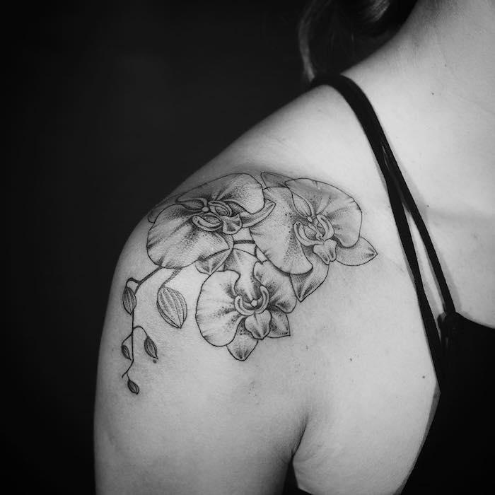 tatouage fleurs orchidée épaules femme