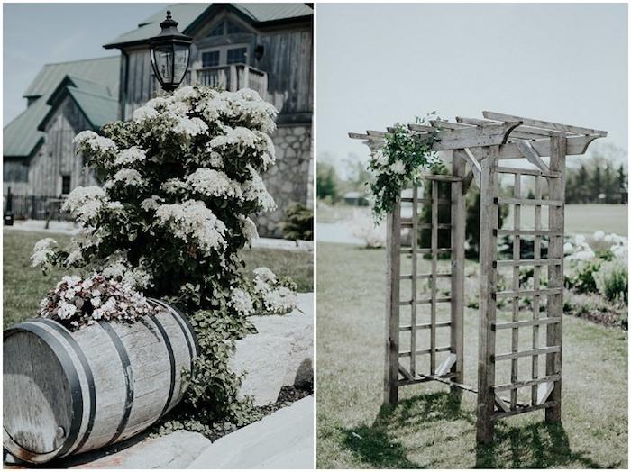 arche en bois fleuri et tonneau vintage avec arbuste à proximité, idée de décoration champêtre dans une grange