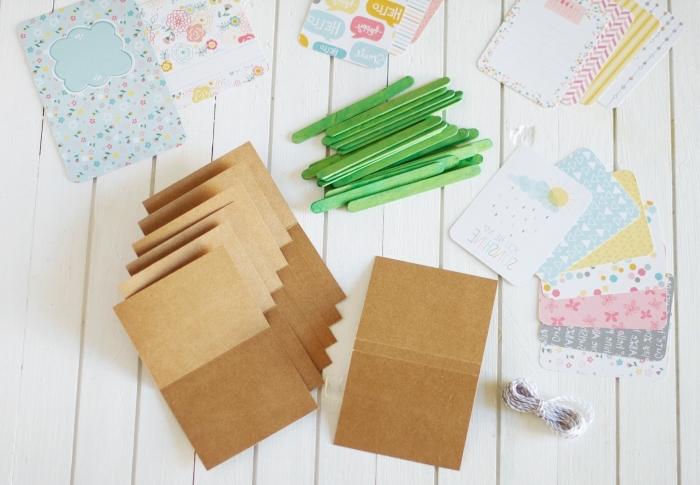 cadeaux personnalisés, guide avec photos pour fabriquer un album personnalisé en papier recyclé et popstickles verts