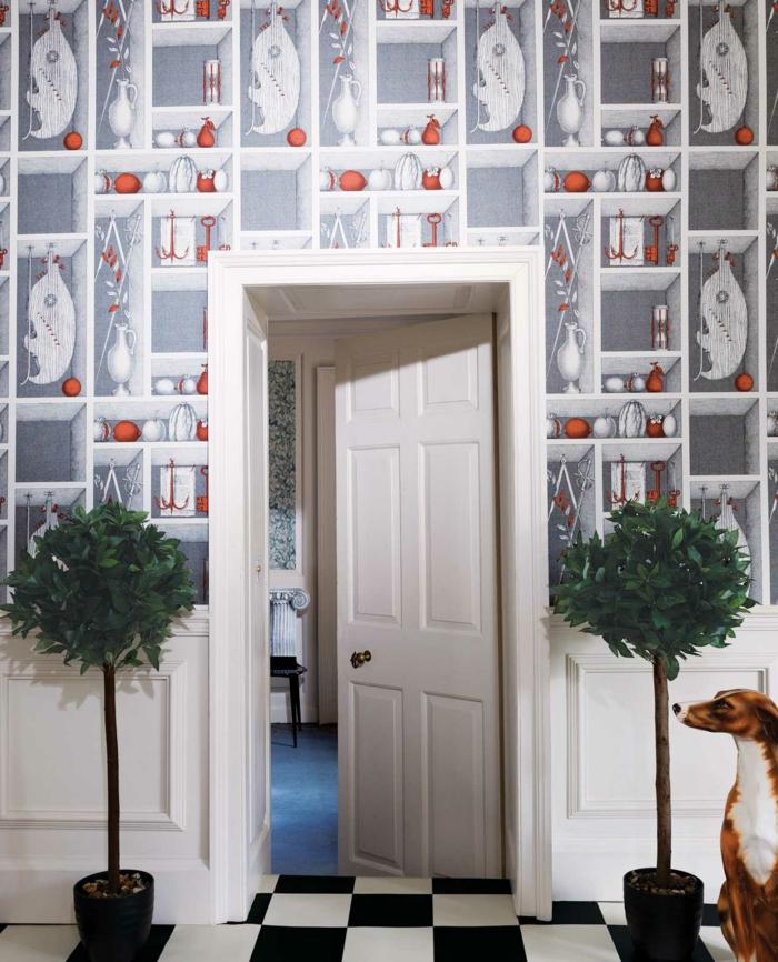 poster geant, murs en style néo classique, papier peint représentant des étagères blanches avec des vases blanches et des boules rouges, sol en noir et blanc, représentant un échiquier