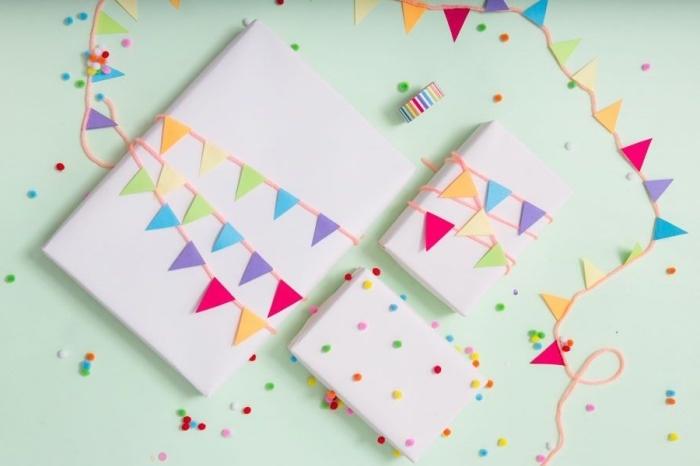 bricolage enfant, emballage boîte cadeau fait main avec feuilles de papier multicolore coupées en triangles