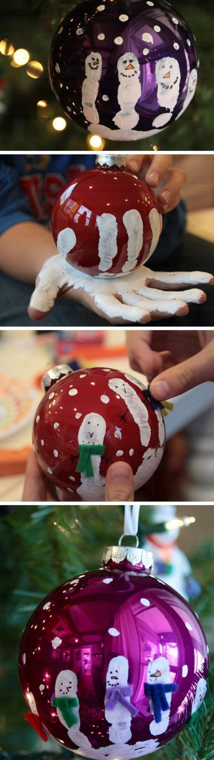 décoration de noel à fabriquer pour adultes, boules rouges et fuchsia, décorées avec une main peinte en blanc, chacun des doigts est un bonhomme de neige, neige dessinée