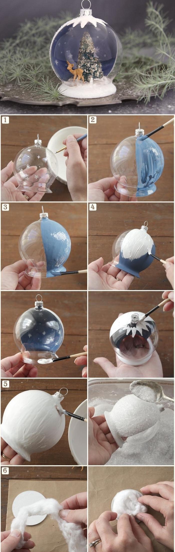 idée pour une decoration de noel fait main qui représente une boule de neige semi-transparente à peinture effet neige, avec des figurines de noël à l intérieur du globe