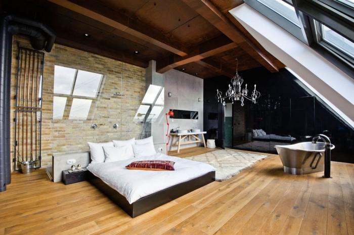 chambre à coucher au grenier avec revêtement murale en pierre et tuyaux apparents de style industriel