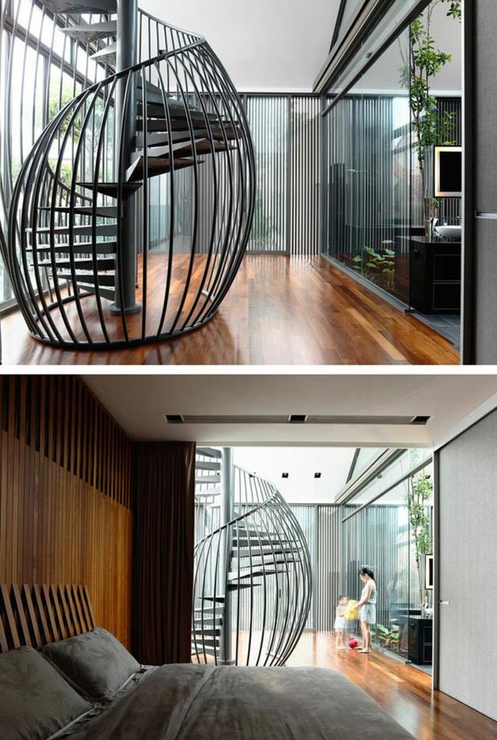 escalier moderne escalier limon central en métal noir, imitant la coquille d'un escargot, avec parquet n beige, marron foncé et clair