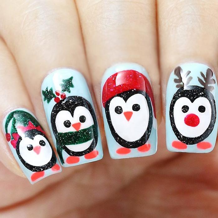 idée d ongle noel simple, vernis à ongles blanc avec motif , machots, pingouins noir et blanc, motif chapeau père noel, bois de cerf et houx de noel