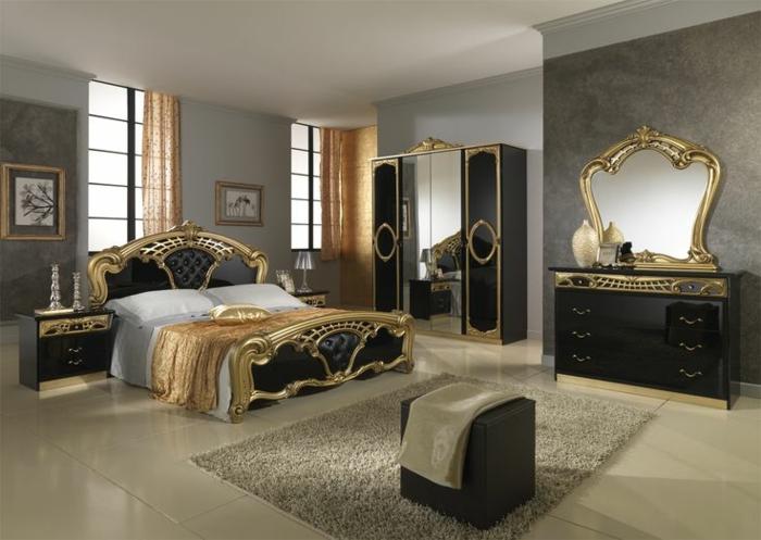 meuble baroque, miroir à l'encadrement doré, commode noire, lit noir et doré