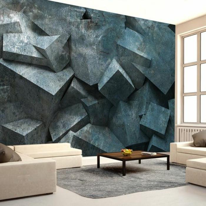 papier peint imitation pierre rocheuse en couleur gris anthracite aux formes pointues, effet 3 D, salon avec grand tapis gris clair et table rectangulaire basse marron, meubles modulables en couleur crème