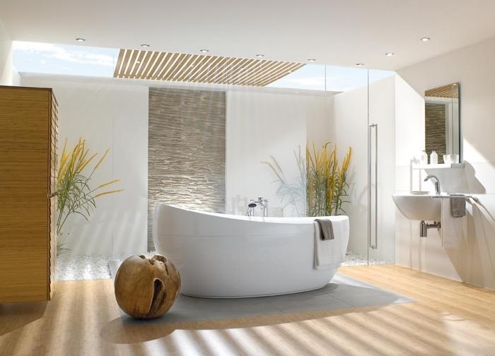 recouvrir carrelage sol, déco salle de bain zen avec galets blancs et plantes vert jaune, plancher en bois clair et carrelage gris
