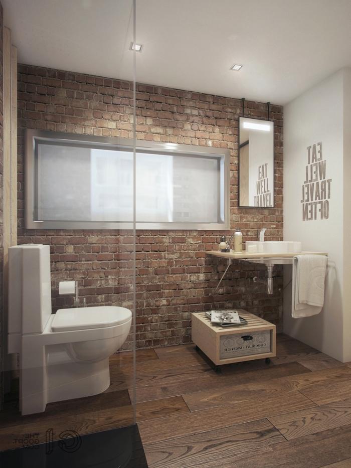 meuble d angle salle de bain, pièce aux murs en briques rouges avec paroi en verre et éclairage led sur le plafond blanc