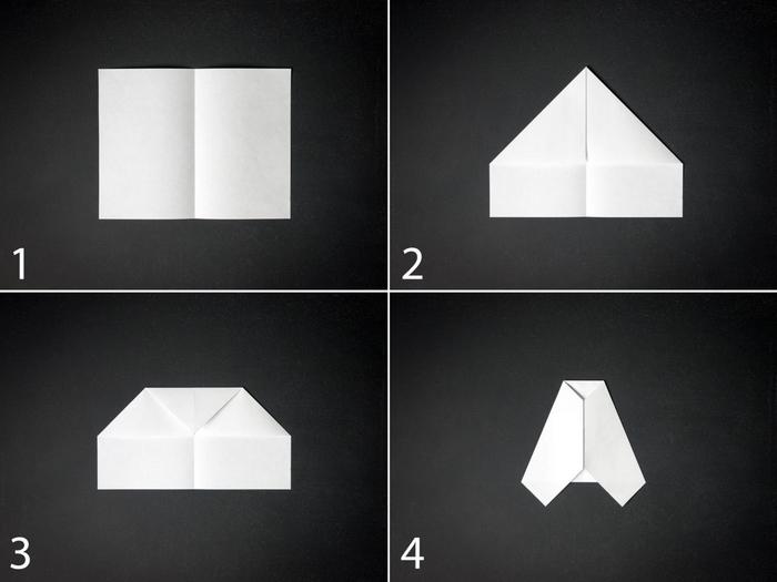 un modèle d''avion en papier qui vole réalisé avec des techniques de pliage de base