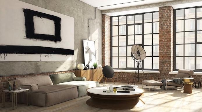 exemple de salon industriel avec canapé gris et marron, table basse bois, mur en briques, tableau abstrait en deco murale, luminaire intéressant