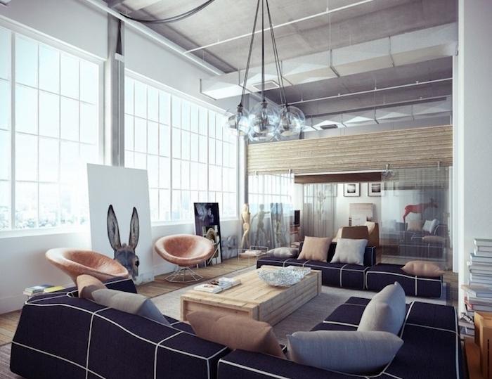 salon industriel avec table basse en planches de bois clair, canapé noir, coussins gris, suspensions boules, fauteuils en cuir, armature apparente, panneau decoratif lapin