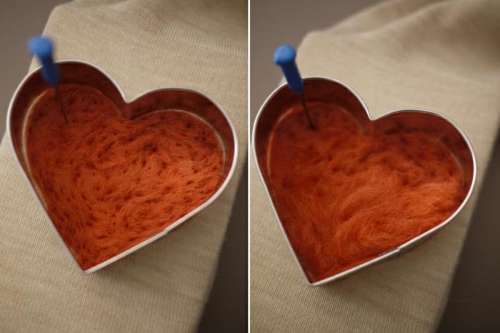 coeur en laine orange formé avec un moule coeur et la technique aiguilletage
