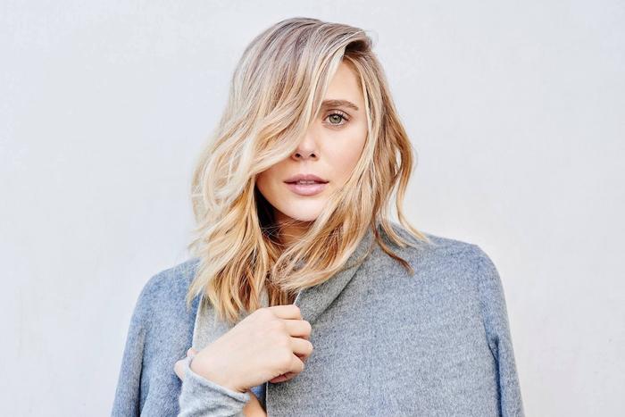 idée pour une coiffure visage ovale avec mèche sur le côté et des ondulations douces qui apporte du mouvement aux cheveux