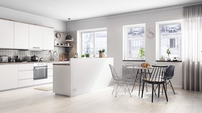 exemple de credence cuisine moderne, parquet clair, meuble cuisine et ilot central couleur blanche, petit coin repas table ronde et chaises design style scandinave