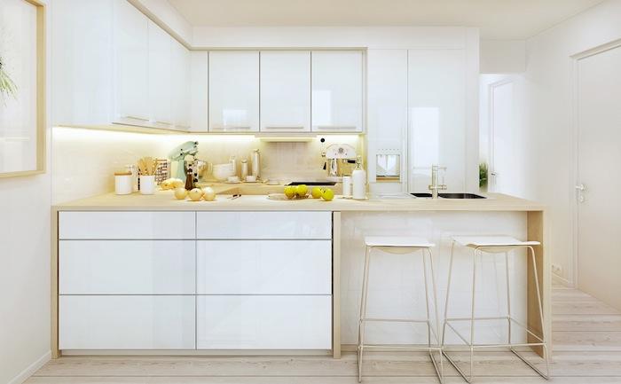 cuisine laquée blanche avec facade et ilot blancs et plan de travail bois, éclairage crédence led, style scandinave