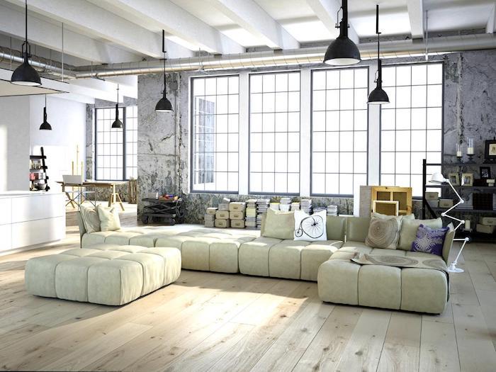déco loft industriel, canapé d angle blanc cassé, parquet bois clair, murs effet beton, suspensions industrielles noires
