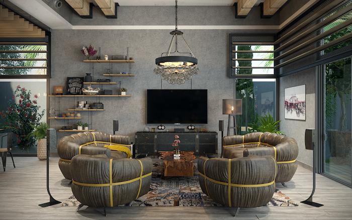 salon style industriel avec canapé et fauteuils gris, parquet grisé, poutres apparentes, etagere bois et metal, meuble tv en coffre bois